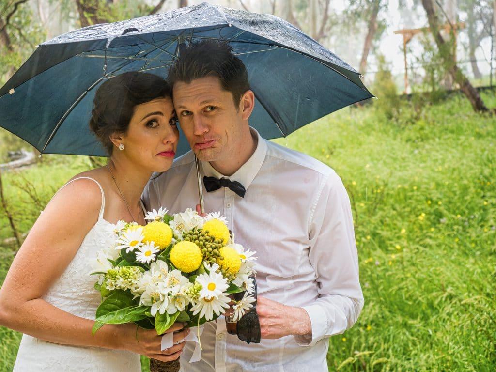 Couple with Umbrella in Rain