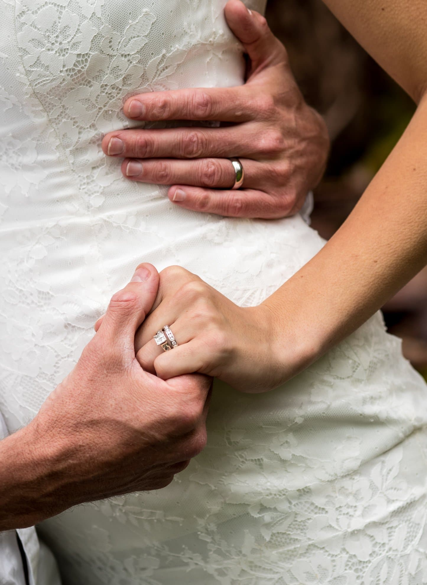 Couple Holding Hands in Front of Dress