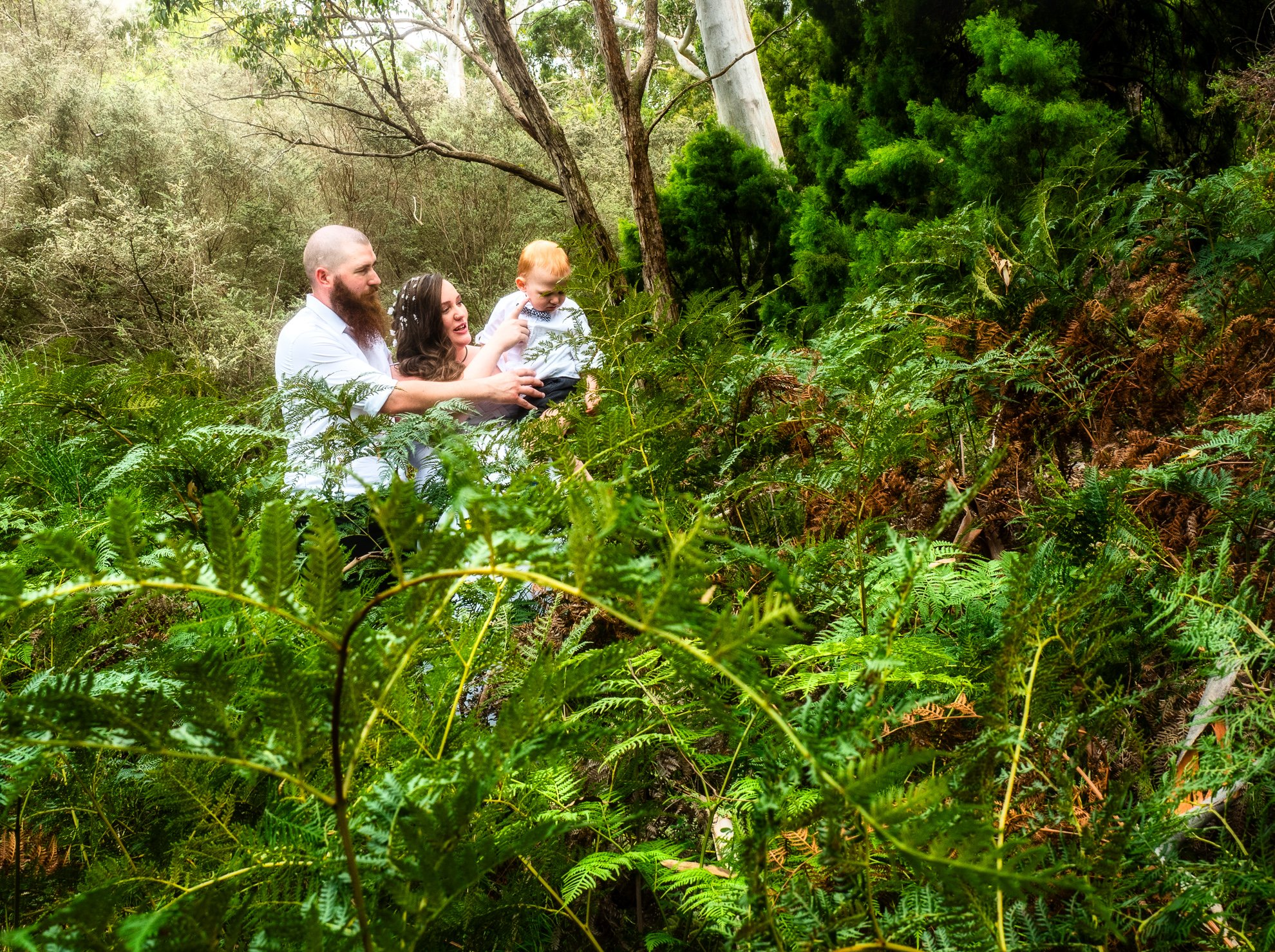 xWedding Couple in Forest with Child