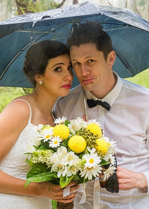 Married Couple under Umbrella